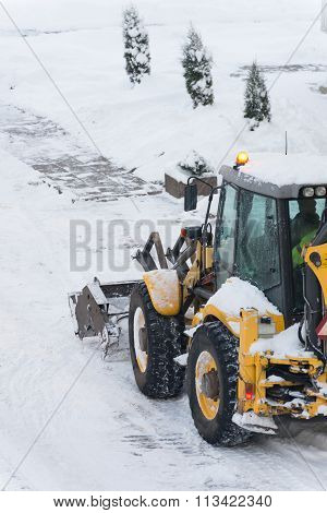 Tractor Shoveling Snow On The Street. Space For Your Text.