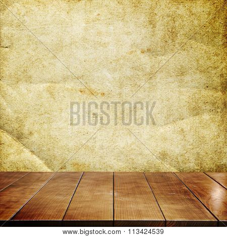 Empty wooden table in grunge interior for product montage