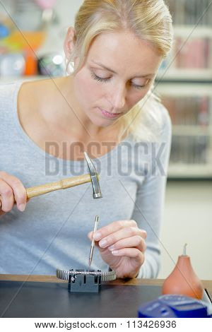 Woman replacing a watch strap
