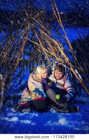 Man And Woman In The Snow In Winter In A Hut, Love