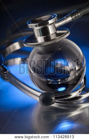 metal stethoscope on globe