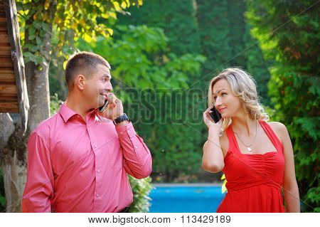 Young Couple Successful Businessmen Agree On The Best Deal. He Was Talking On The Phone, It Searches