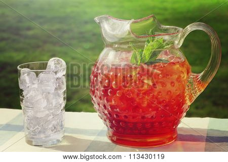 Pitcher of Iced Tea, outdoors in the summertime