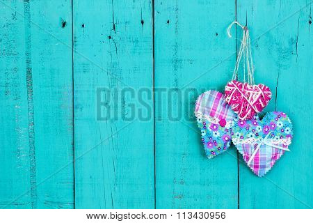 Hearts hanging on old wooden background