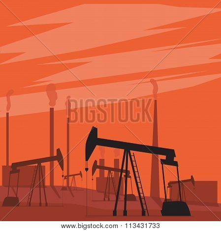 Oil pumps in the field. Landscape with sunset