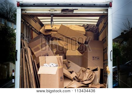 Removal van with untidy boxes dumped inside