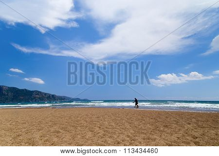 Two Figures Of The Person In The Distance On A Beach To Iztuz, Turkey, Dalyan