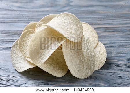 Potato chips on blue