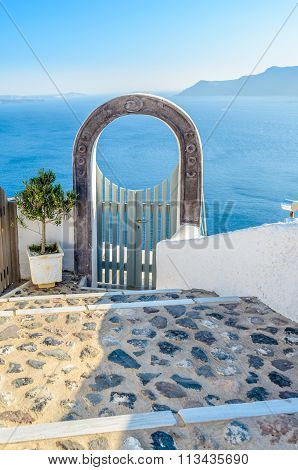 Beautiful arched gateway above the sea in Oia, Santorini