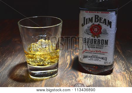 Jim Beam bourbon whiskey on wooden table
