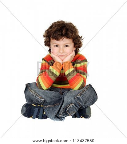Nice boy with seven years old sitting on the white floor thinking