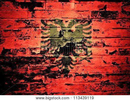 flag of Albania painted on brick wall