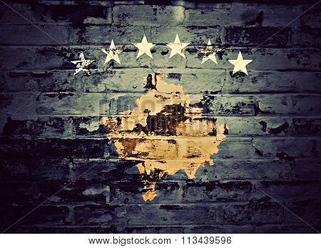 flag of Kosovo painted on brick wall