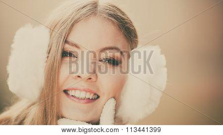 Portrait Of Pretty Smiling Woman In White Earmuffs