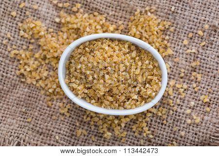 Raw Bulgur (on Wooden Background)