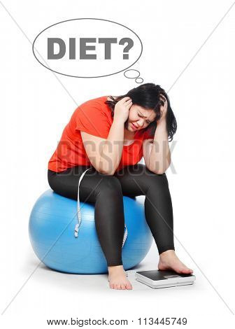 Frustrated obese woman on weight. Picture on slimming theme.