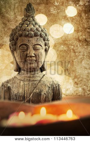 Buddha sculpture with candles
