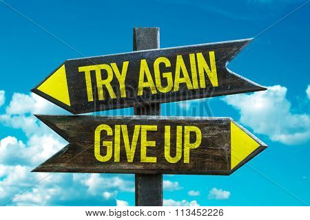 Try Again - Give Up signpost with sky background