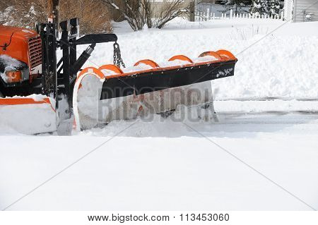 snowplow removing snow in winter