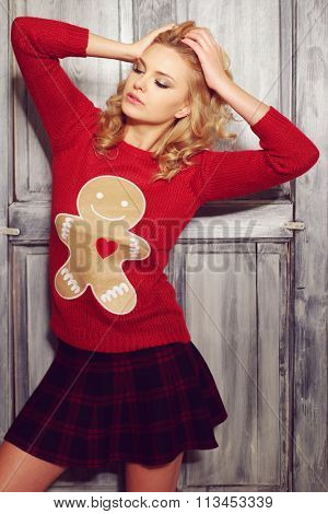 Sultry blond woman in red ginger bread man sweater