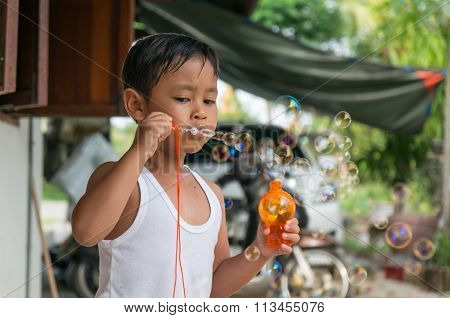 Asian boy playing with soap bubbles, Boy with Bubbles