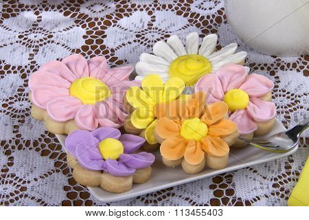 Flower Sugar Cookies on square plate white lace table cloth