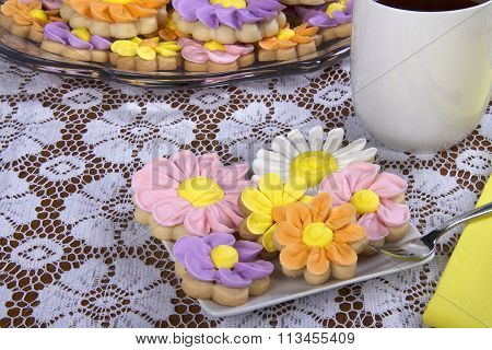 Flower Sugar Cookies in square plate white lace table cloth