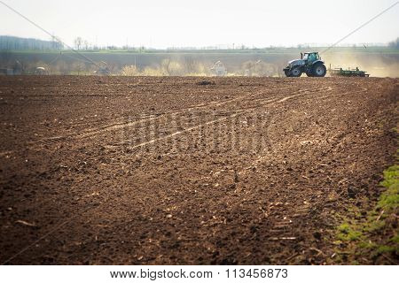 Panorama Of Operating Tractor In Field