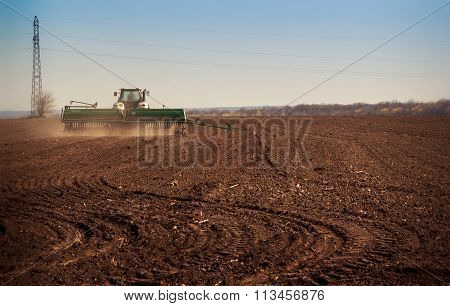 Panorama Of Tractor Sowing In Field