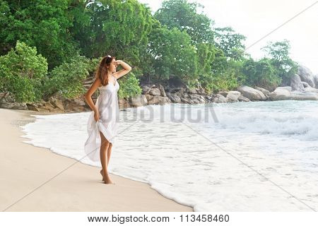 Beautiful girl looking far away being on the seacoast in Thailand.