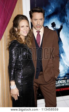 WESTWOOD, CALIFORNIA - December 6, 2011. Robert Downey Jr. and Susan Downey at the Los Angeles premiere of
