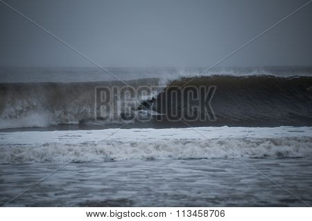 Surfer Tucking Into A Barrel