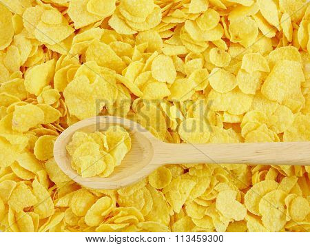 The tasty golden corn flakes and wooden spoon
