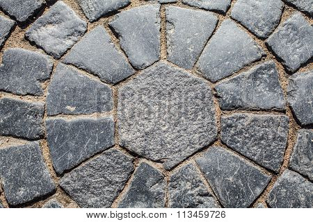 Ancient paving. Sidewalk street paved with cobblestones.