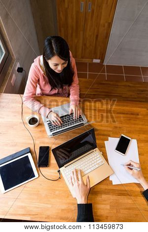 Top view of people work together at home