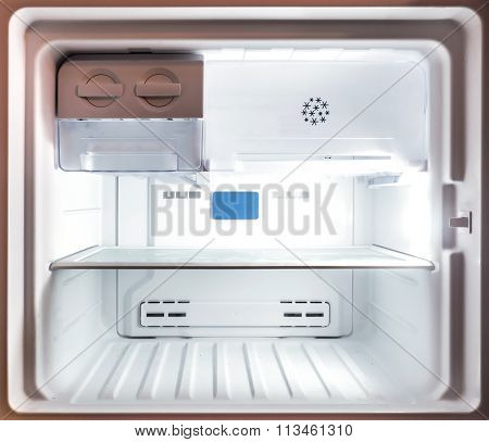 Close up inside an empty white freezer fridge (refrigerator)