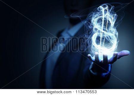 Man showing dollar symbol