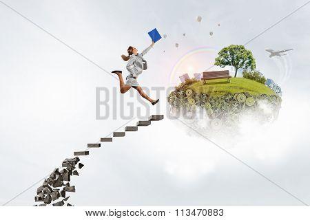 Businesswoman climbing stone ladder
