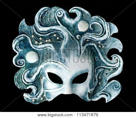 Interior and carnaval mask embodying the element of water, isolated on black background