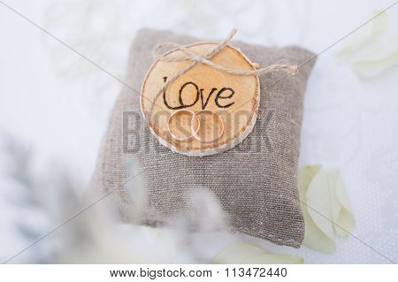 Two Wedding Rings On The Pillow With Love