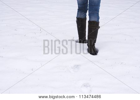 boots trudging through snow