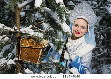 Snegurochka (snow Maiden) With Gifts Bag In The Winter Forest