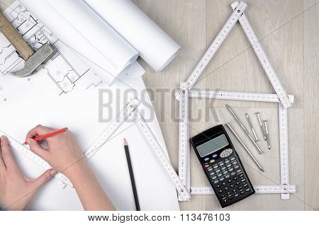 Hands Of Engineer Working With The Tool On Project Drawings Background