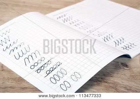 Exercise Book On The Wooden Table