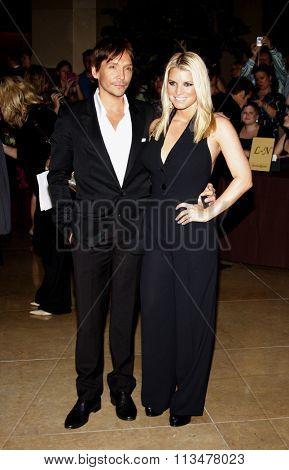 Jessica Simpson and Ken Paves at the Operation Smile's 8th Annual Smile Gala held at the Beverly Hilton Hotel in Beverly Hill, California, United States on October 2, 2009.