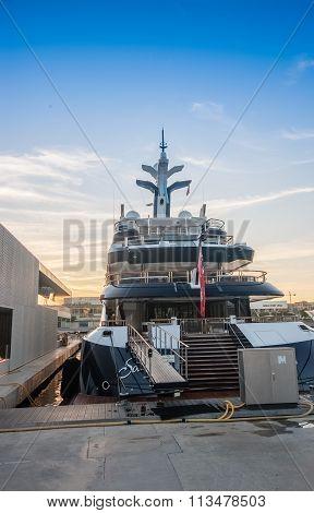 Barcelona, Spain - November 10, 2015: Luxury Yacht Docked In Harbor Vell Port At Sunset On November