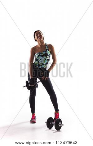 Woman exercising with dumbbells isolated on white