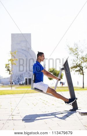 Man exercising in a machine at a public park