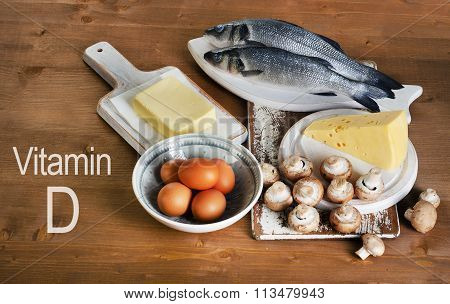 Foods Containing Vitamin D On A Wooden Table.