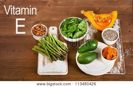 Foods Containing Vitamin E On A Wooden Background.